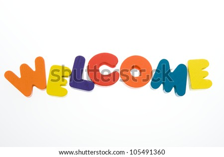 "Wooden letters spelling the word  "" welcome ""  on white background."