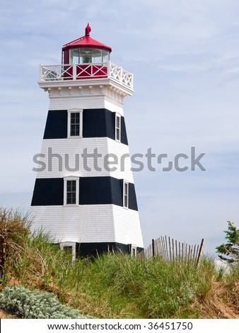 Wooden Lighthouse at West Point, PEI, Canada, distinguished by its black stripes