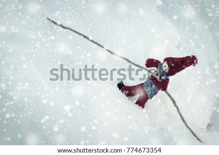 wooden little toy in winter...