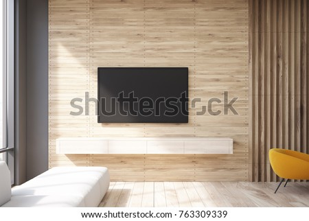 Wooden living room interior with a TV set hanging on the wall and a narrow sofa near a panoramic window. 3d rendering mock up