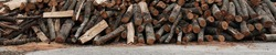 Wooden logs background. Stacked Firewood. Wood chips. Pile of chopped firewood. Hi Res banner.