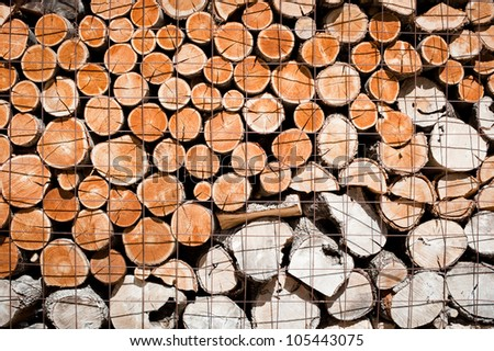 Wooden logs stacked and stored