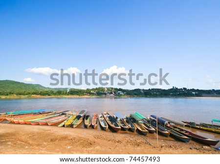 wooden long tail boats at river