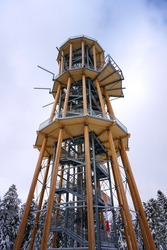 wooden lookout tower in the forest