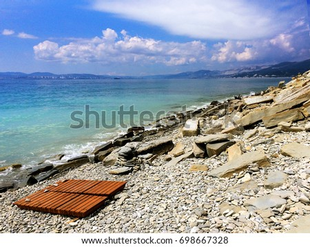 Wooden lounge chairs on a beautiful beach. Seascape with turquoise water  #698667328