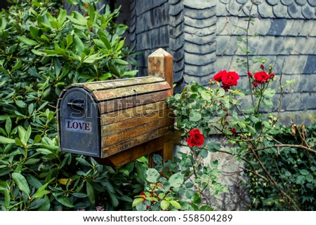 wooden mail box in flower...