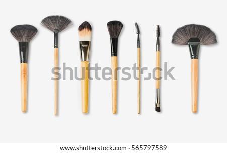 wooden make-up brushes isolated on white background #565797589