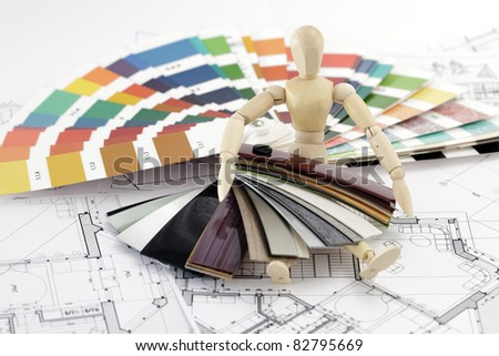 wooden man, a palette of colors designs for interior works, samples of plastics, PVC, for furnishing and architectural drawings houses - stock photo