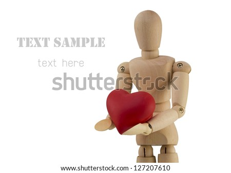 wooden man figure holding in hands red heart (with clipping path