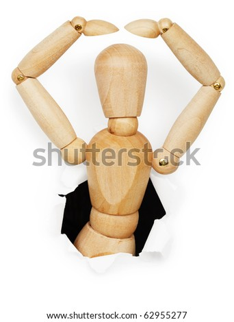 Wooden man leaned out of the hole in paper