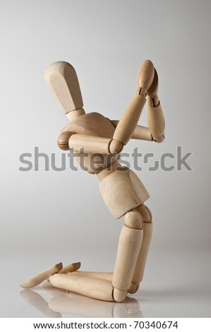 wooden man praying