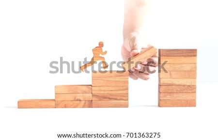 wooden man run across cliff, business challenge #701363275