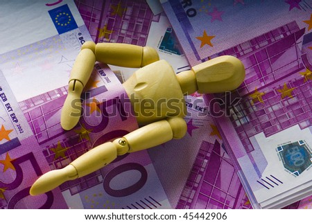 wooden man sleeps under a money