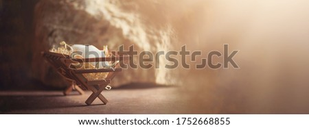 Wooden manger and star of Bethlehem in cave, nativity scene background. Christian Christmas concept. Birth of Jesus Christ. Jesus is reason for season. Salvation, Messiah, Emmanuel, God with us, hope. Stock photo ©