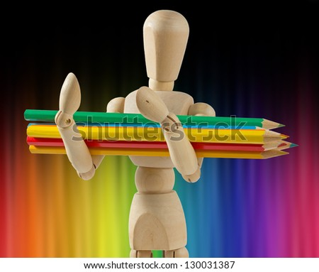 Wooden Mannequin Carrying Coloured Pencils