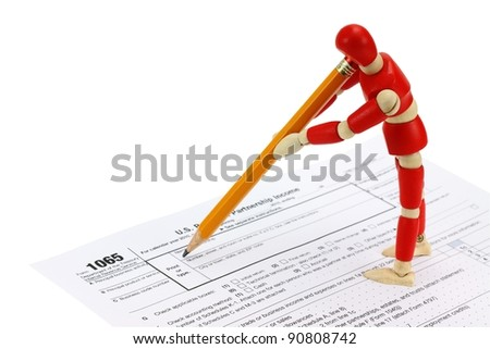 Wooden mannequin completing the 1065 Tax form for LLC's