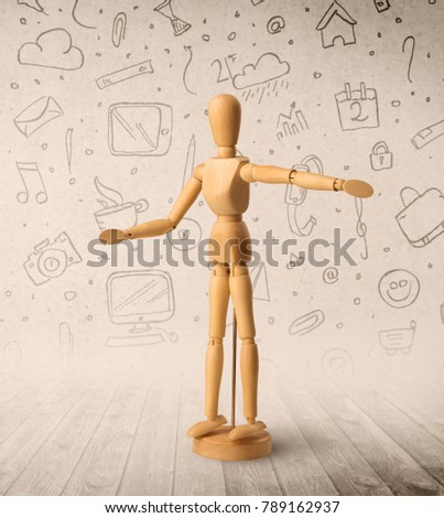 Wooden mannequin posed in front of a greyish background with mixed media scribbles behind it #789162937