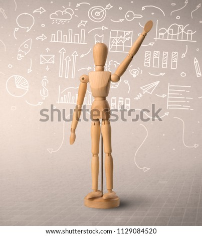 Wooden mannequin posed in front of a greyish background with white scribbled data around him #1129084520