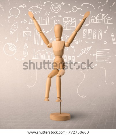 Wooden mannequin posed in front of a greyish background with white scribbled data around him #792758683