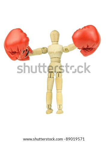 Wooden mannequin with boxing gloves