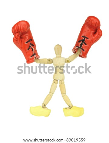 Wooden mannequin with boxing gloves and wooden shoes