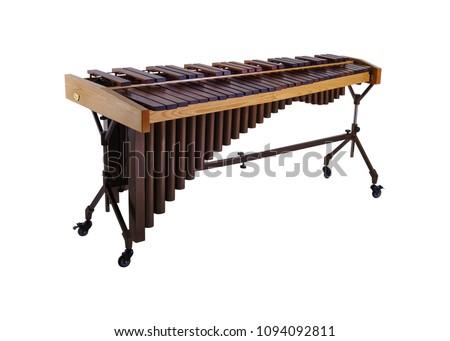 Wooden marimba, musical instrument isolated on white background.