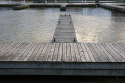 Wooden marina lakeside dock empty of boats