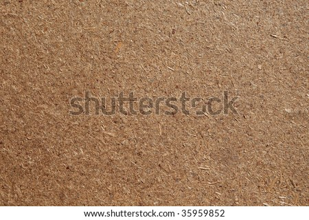 Wooden material background for construction theme. Chipboard. Medium Density Fiberboard Plate.