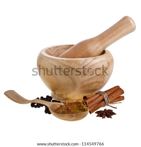 Wooden mortar, cinnamon, pepper and anise