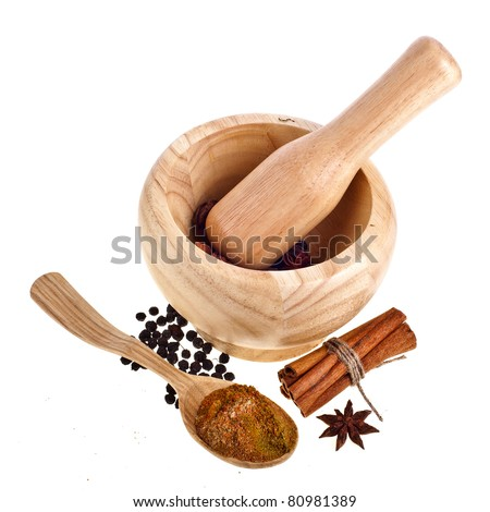 Wooden mortar, spoon and spices isolated on white background