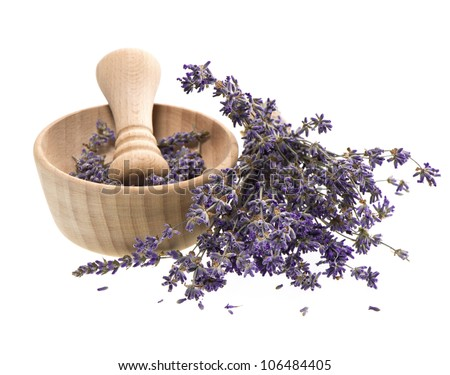 wooden mortar with dry lavender flowers over white background