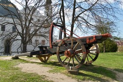 Wooden multi-barreled cannon as a decoration and memory at the castle
