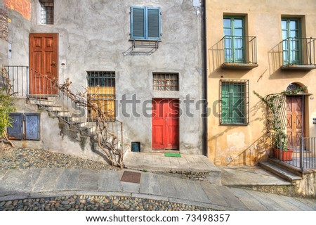 Wooden multicolored doors in the old house at the town of Saluzzo, northern Italy.