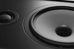 Wooden multimedia system in black close-up. Loudspeakers. Audio speakers.