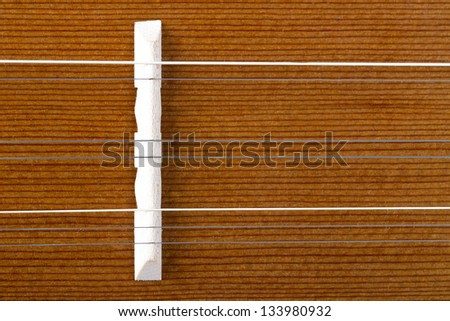 Wooden musical instrument with strings.