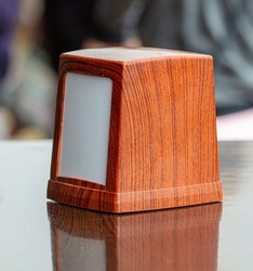 Wooden napkin holder on the table in the dining room.