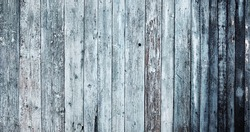 Wooden natural background.Fragment of old wooden house wall cladding with blue and blue peeling paint.