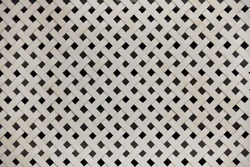 Wooden netting on the diagonal, white lattice. The holes are diamond-shaped. Decorative grid panel
