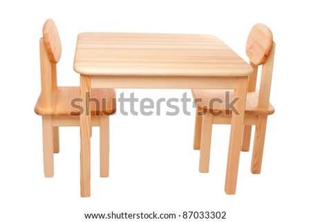 Wooden new table and two chairs isolated on white background