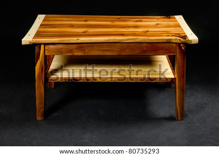 wooden night table - piece of furniture in front of black background