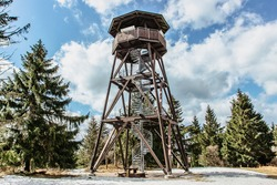 Wooden observation tower called Anna on Anensky Peak in Orlicke (Eagle) Mountains,Czech Republic.Spiral staircase of lookout tower, construction with metal steps and oak platform.Czech tourist place