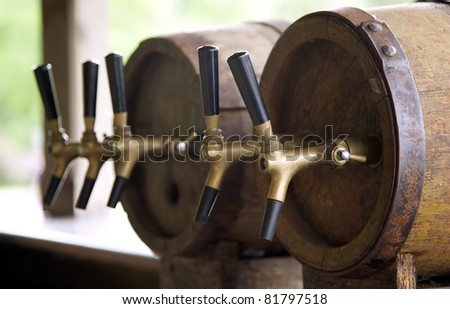 Wooden old barrels with pipe for cold and refreshing beer