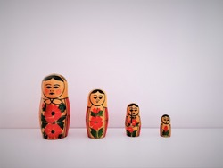 Wooden old russian doll formed by four dolls of different size