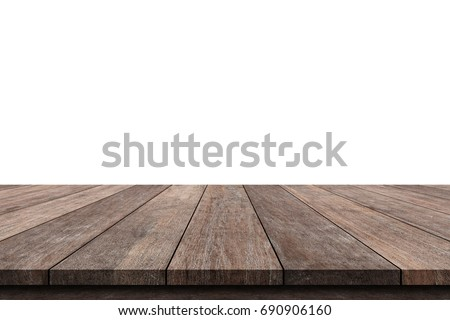 Shutterstock Wooden old table isolated on white background. For your product placement or montage with focus to the table top in the foreground. Empty wood brown shelf. shelves