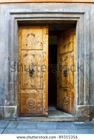 Wooden Open Door with Knockers In The Form Of a Lion's Head