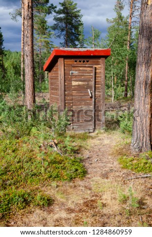 Wooden outhouse or toilet in a forest in Norway