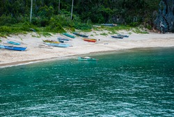 Wooden outrigger boats use for small scale fishing common in coastal villages in the Philippines