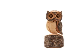 Wooden owl (Strigiformes) carved from wood, handcrafted. copy space. isolated on white. Front view.