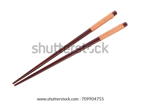Wooden pairs of chopsticks on white background