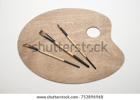 Wooden palette with brushes #753896968